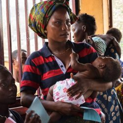 A woman brings her child to the EMERGENCY Paediatric Centre in Bangui