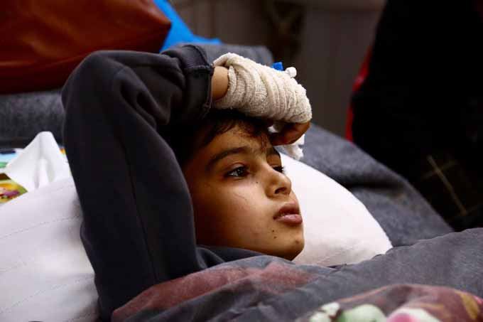 A child in one of the Erbil's Emergency Hospitals beds