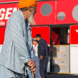Outside one of EMERGENCY's Mobile Clinics, an old man waits for his turn to be visited