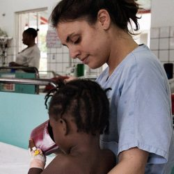 An EMERGENCY nurse taking care of a child in one of the EMERGENCY's Paediatric Centre wards