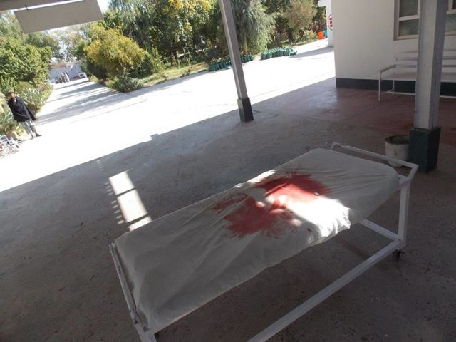 After a mass casualty management, a blood-stained stretcher left outside the door of the OPD of our Surgical Centre in Lashkar-gah, Afghanistan